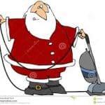 Santa cleaning carpet at Christmas